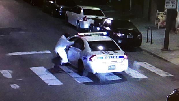 A gunman, identified by police as Edward Archer, takes aim at Philadelphia Officer Jesse Hartnett Jan. 7, 2016, in a still taken from police camera footage.