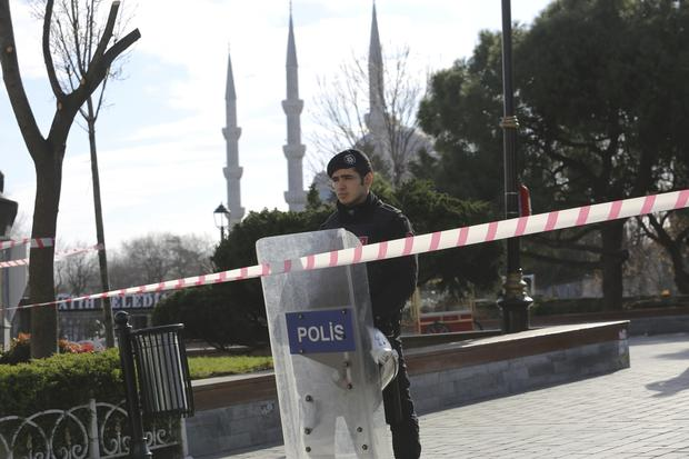 A police officer secures the area after an explosion near the Ottoman-era Sultanahmet mosque, known as the Blue mosque in Istanbul