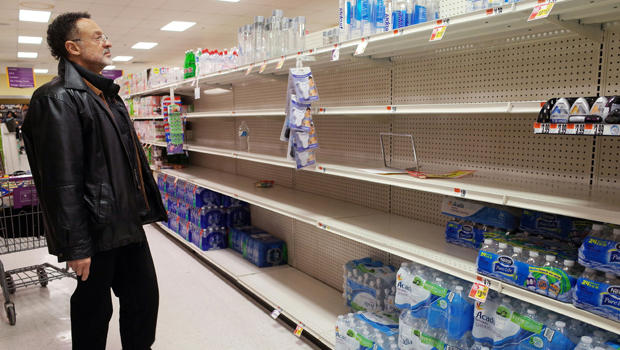 A shopper looks at the bottled water section at a supermarket on Jan. 21, 2016, ahead of an expected blizzard in Washington, D.C.