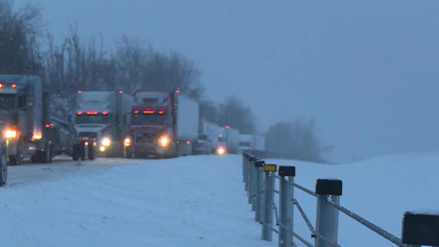 Trucks are stuck on Interstate 75 south of Lexington, Kentucky, Jan. 22, 2016.
