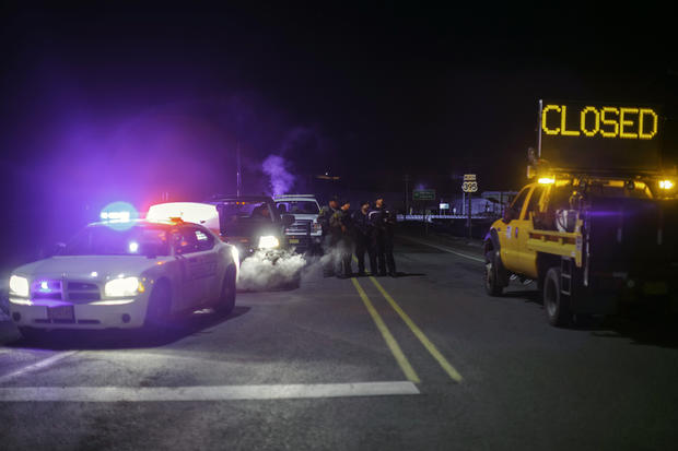 Law enforcement personnel monitor an intersection of closed Highway 395 in Burns, Oregon, Jan. 26, 2016, during a standoff pitting an anti-government militia against U.S. authorities.