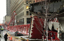 "Witness: Crane ""somersaulted"" to the ground"