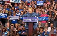 Clinton sweeps four more states, Sanders pushes on