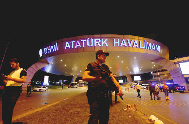 Riot police officer stands guard ealrly on June 289, 2016 at entrance of Ataturk airport in Istanbul, Turkey, following gunfire and multiple suicide bombings the day before