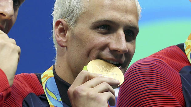 Ryan Lochte and his teammates appear with their gold medals after the men's 4x200m freestyle relay final in the Rio 2016 Summer Olympic Games at Olympic Aquatics Stadium Aug 9, 2016, in Rio de Janeiro, Brazil.