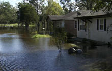Cresting rivers in North Carolina threaten to cut off communities