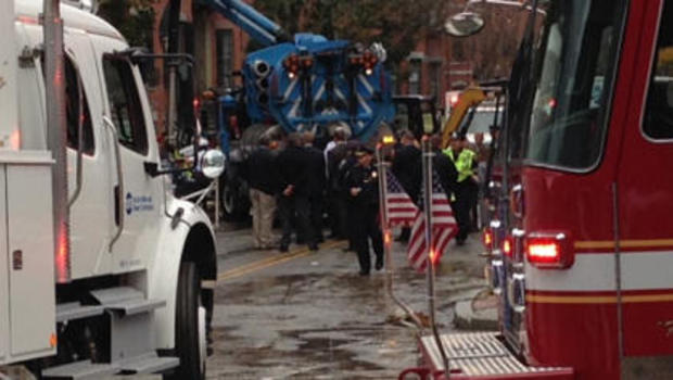 First of 2 dead workers recovered in Boston