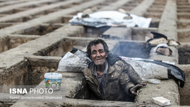 Image result for Pictures of homeless sleeping in empty graves shock Iran