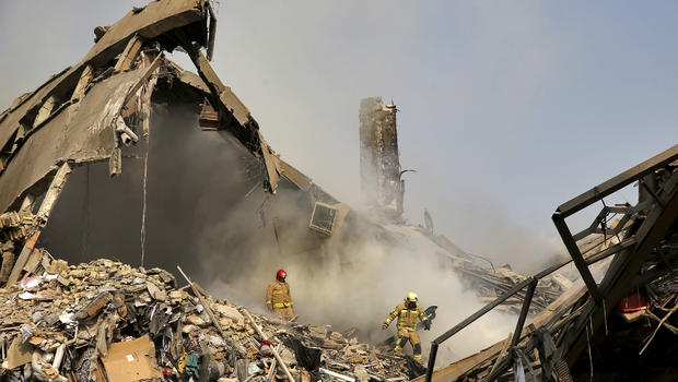Dozens of Firefighters Killed as Iconic Building in Tehran Collapses