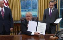 Trump signs executive memos on trade, abortion, federal hiring