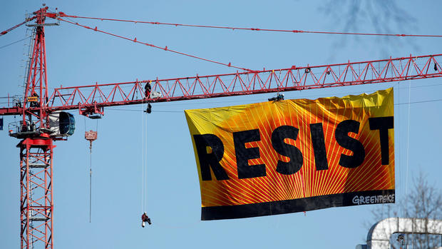 Greenpeace protesters shut down DC streets