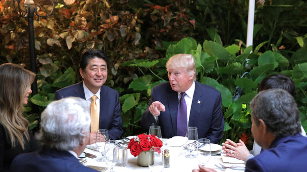 Japanese Prime Minister Shinzo Abe and Akie Abe, right, partially obscured, attend dinner with President Trump, his wife Melania and Robert Kraft, second left, owner of the New England Patriots, at Mar-a-Lago Club in Palm Beach, Florida, Feb. 10, 2017.