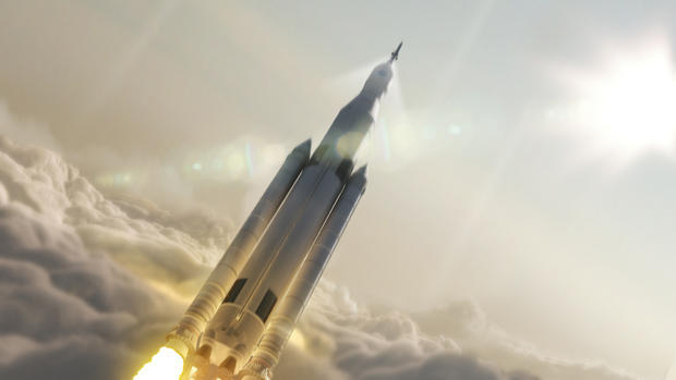 An artist's impression of a Space Launch System rocket boosting an Orion crew capsule toward space.