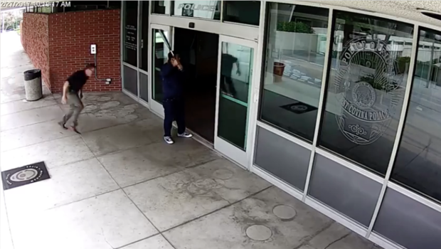 Cali. officer tackles man with bat outside police station