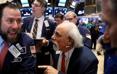 Dow crosses 21,000, and other MoneyWatch headlines
