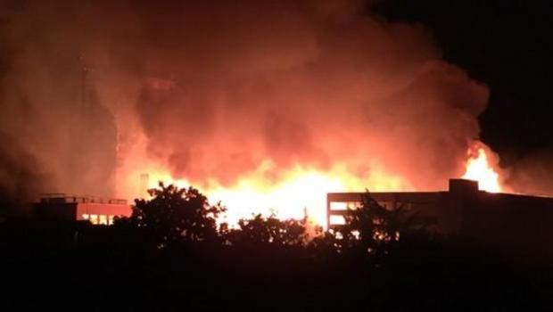 Huge fire threatens businesses in Raleigh, NC, people possibly