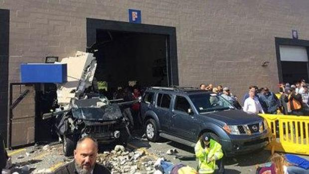 SUV accelerates, crashes during auto auction; 3 dead, 9 hurt