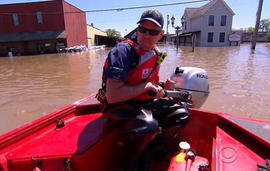 River spills across historic Arkansas town after heavy rains