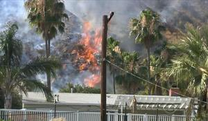 Wildfire threatening homes in Southern California