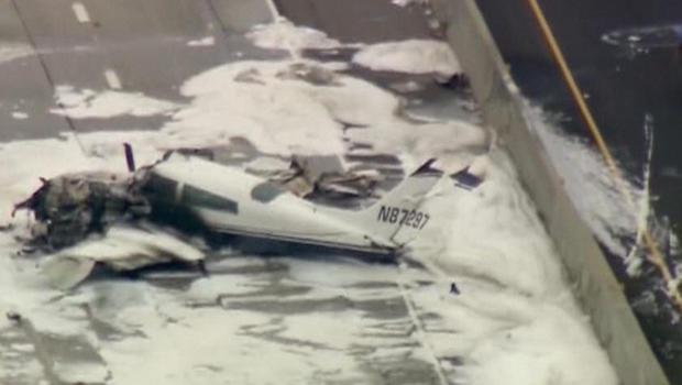 Small plane crashes onto California freeway