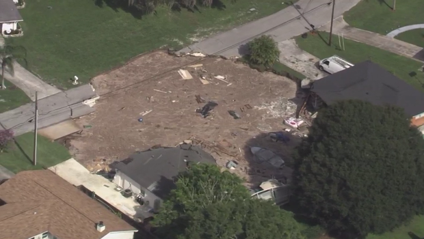 Homes were evacuated after a sinkhole formed Friday morning in a Land O Lakes Florida neighborhood.                                               WTSP-TV