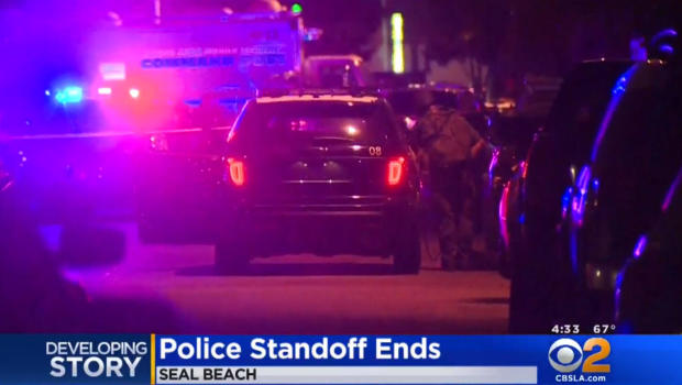 SWAT officers storm apartment after standoff, find 2 dead