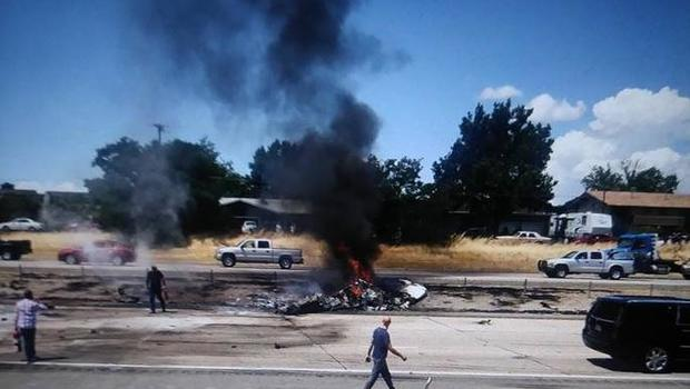 Small plane crashes on Utah freeway, killing two married couples