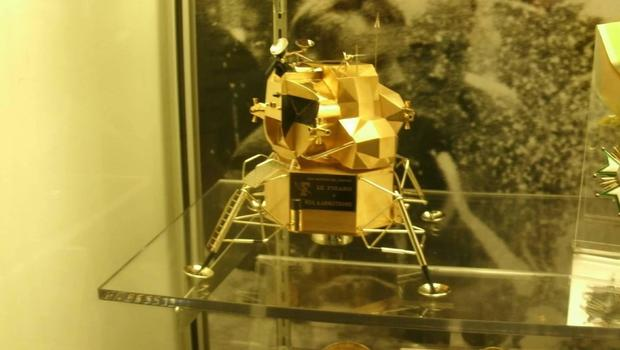 Some frightful human being stole Neil Armstrong's solid gold lunar lander model