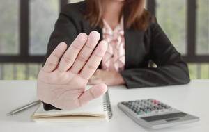 Business woman says no or hold on at her office