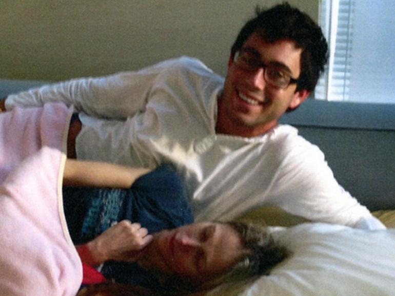 Jake Nolan and Dr. Pamela Buchbinder in her bed