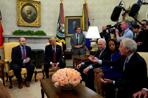 Senator Bob Corker (R-TN) talks to U.S. President Donald Trump and Josh Holt, an American missionary who was released by Venezuela, in the Oval Office of the White House in Washington