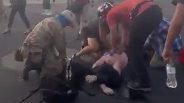 Attendees help a man who was shot and wounded in Albuquerque