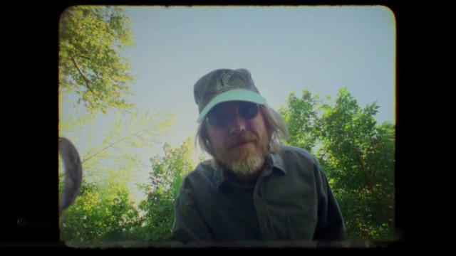 cbsn-fusion-never-before-seen-video-of-tom-petty-at-home-while-recording-wildflowers-thumbnail-533193-640x360.jpg