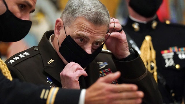 Milley puts his mask back on after U.S. President Donald Trump presented the Medal of Honor in Washington