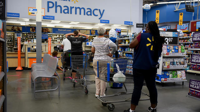 Shoppers wait at Walmart pharmacy