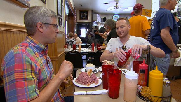 mo-rocca-mike-polk-jr-corned-beef-sandwich-at-slymans-cleveland-620.jpg