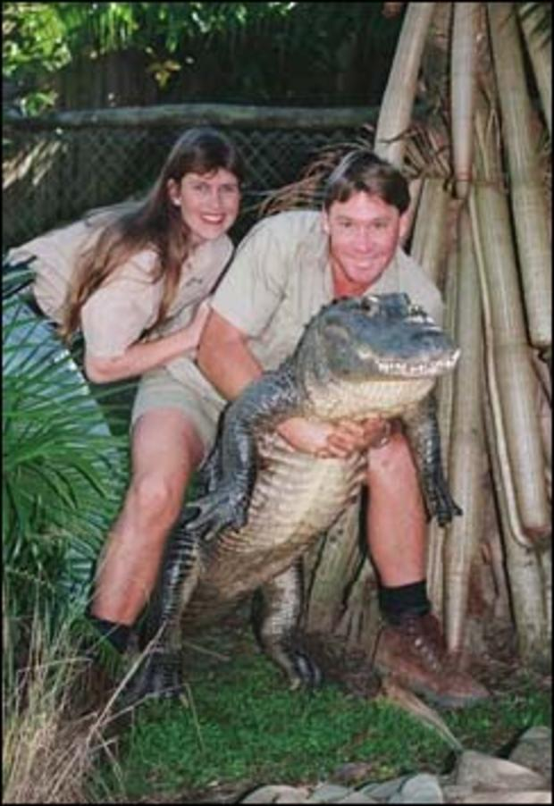 "Steve Irwin of the TV show ""The Crocodile Hunter"" poses with his wife Terri while holding a nine-foot alligator at his ""Australia Zoo,"" Beerwah, Queensland, Australia, June 18, 1999."