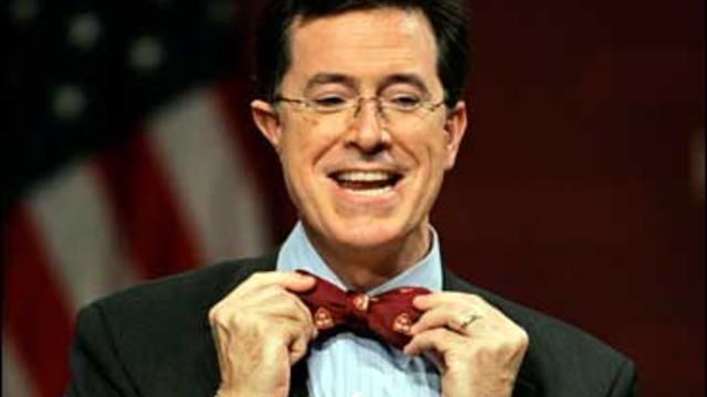 Comedian Steven Colbert puts on a Harvard bow tie