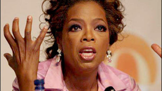 Oprah Winfrey gestures during a news conference