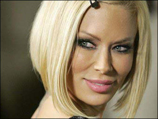 Jenna Jameson poses on the red carpet