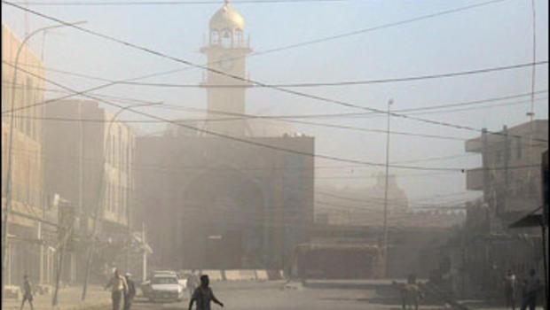 Smoke billows from the Shiite Imam al-Askari shrine in the restive city of Samarra, north of Baghdad, 13 June 2007.