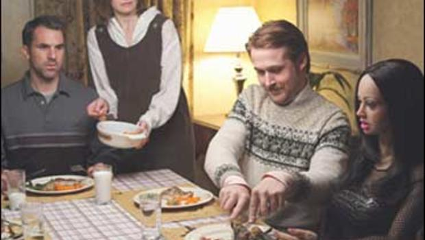 """Paul Schneider, Emily Mortimer, Ryan Gosling and """"Bianca,"""" in """"Lars and the Real Girl"""" (2007)."""