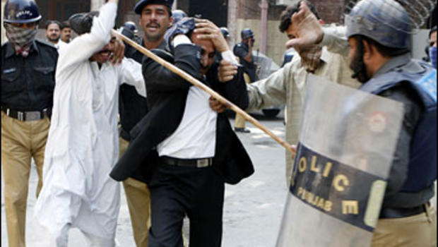 Police officers beat lawyers who were protesting against state of emergency imposed by the military ruler President Gen. Pervez Musharraf, Monday, Nov. 5, 2007 in Lahore, Pakistan.