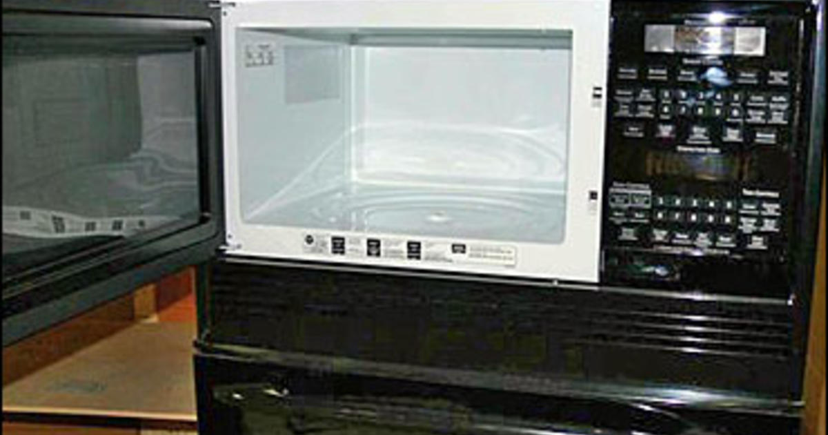 Ge recalls 92 000 microwaves cbs news - How to vent a microwave on an interior wall ...