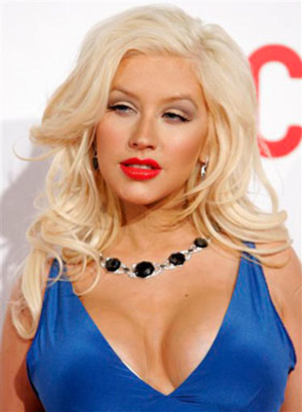 Singer Christina Aguilera poses on the press line at the opening gala celebration of the Broad Contemporary Art Museum at LACMA in Los Angeles in this Feb. 9, 2008 file photo. Aguilera debuted her newborn son Max on the cover of People magazine last week