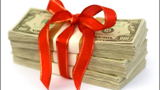 Stack of money wrapped in red bow and ribbon.