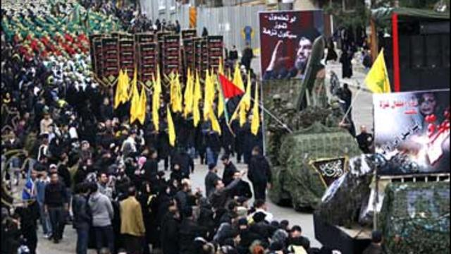 Leabnese Hezbollah supporters, march during a demonstration to protest against the Israeli ground attack on the Gaza Strip