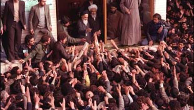 Ayatollah Ruhollah Khomeini, center, is greeted by supporters after arriving at the airport in Tehran Iran in this Feb. 1, 1979 photo