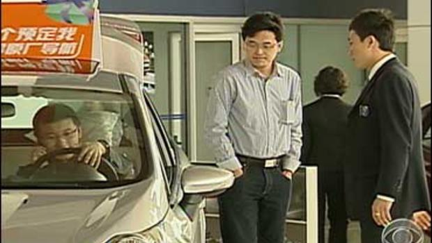 Chinese carbuyers in showroom