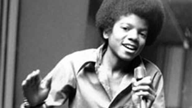 In this 1972 file photo, singer Michael Jackson at age 13, the youngest member of the singing group Jackson Five, sings in his home in Encino, Ca. (AP Photo, file)